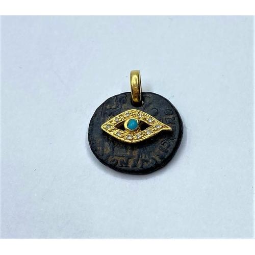 373 - 18ct diamond and turquoise on jet pendant