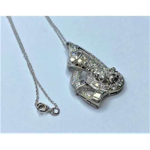 50 - Platinum and Diamond PENDANT; 8.2g    In excess of 2 ct of diamonds.