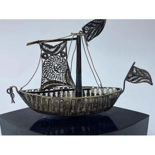 539 - Silver filigree Viking ship on a stand, 14cmsx10cm