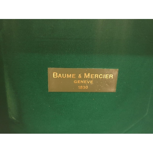 5 - Baume and Mercier, lockable with key Geneve gimballed travelling CLOCK, in walnut case, Quartz mecha...