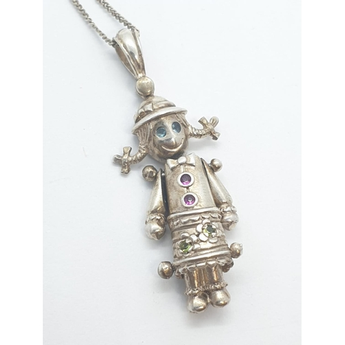 280 - Silver rag doll pendant and silver chain, rag doll having blue sapphire eyes and pink sapphire butto...