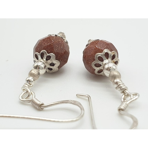 336 - Pair of silver drop earrings having graduated silver ball finished with large bronze faceted ball an...