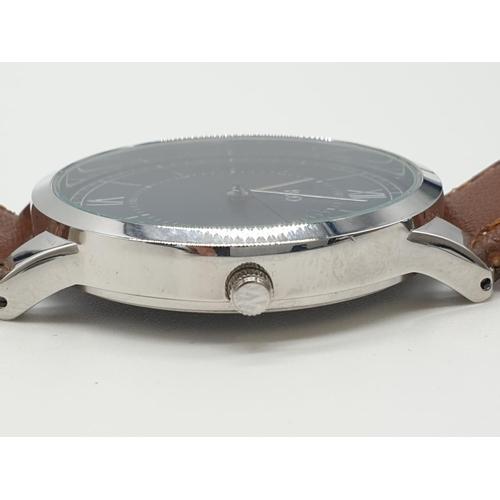 486 - Gent Rio large blue face wristwatch, quartz movement brown strap, full working order