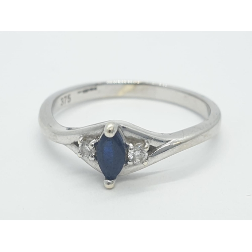 93 - 9ct white gold ring having marquise shaped sapphire to centre with diamond shoulders, full UK hallma...