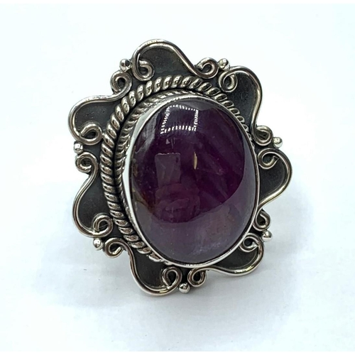 216 - A star Ruby gemstone ring in sterling silver, size Q
