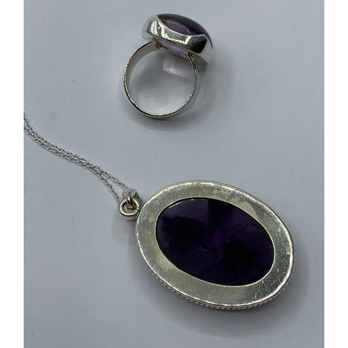 237 - An Amethyst gemstone pendant with matching Amethyst ring in sterling silver, size M & length of chai...