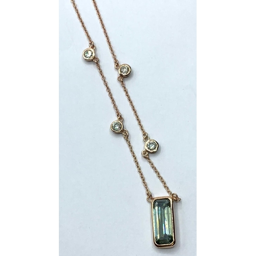 348 - A blue Moissanite chain necklace , center stone 4cts and two accents white moissanite stones .20ct e...