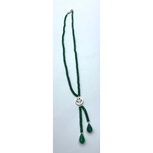 405 - An emerald necklace in unique style with two emerald drops which flow below, 91cts, length 44cm