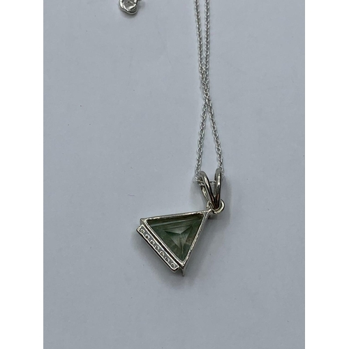 416 - 3.95cts Blue Moissanite Trilion shape pendant in sterling silver with 925 silver chain