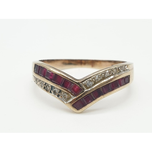 247 - 9ct Gold CHEVRON RING with diamonds and Pink Rubies.  2.4g   Size 0