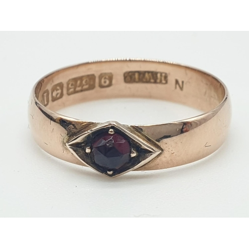 301 - 9ct gold RING having faceted garnet to top.  Clear full UK Birmingham hallmark.  Dainty and neat rin...