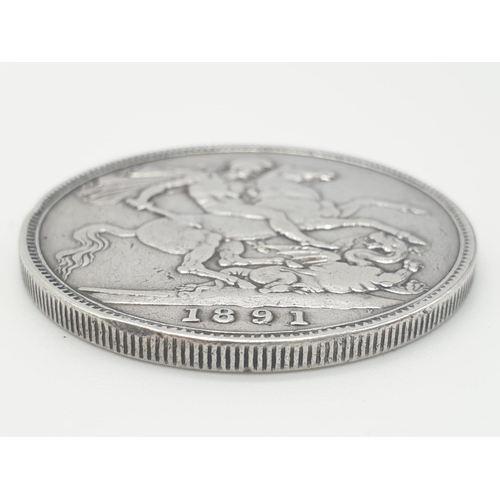 322 - Silver Victorian CROWN 1891.  Fine/Very fine condition.  Having clear definition and bold wording.  ...