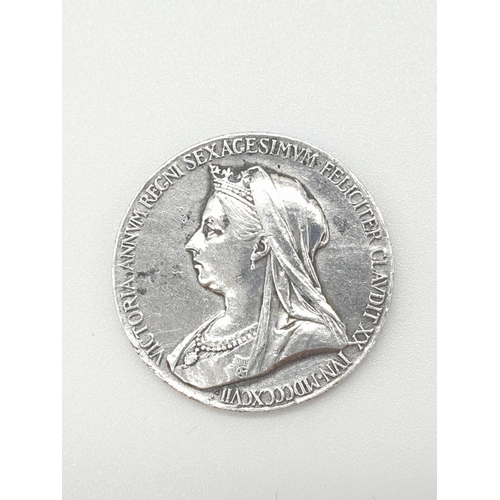 396 - Victorian silver COIN minted in 1897 to celebrate 60 years of Queen Victoria's reign.  Having young ...