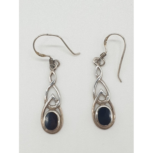 509 - Pair of silver and black onyx DROP EARRINGS in Renee Mackintosh style with Celtic infuence.  Marked ...
