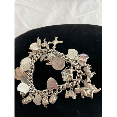 310 - Silver Charm Bracelet absolutely full of silver charms to include Silver Heart Padlock, Celtic Cross...