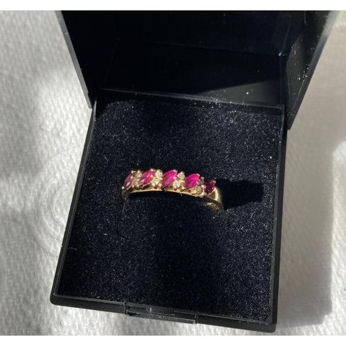 399 - 9ct Gold Ring having 5 rubies in baguette form interspaced with 4 pairs of Diamond Points. Full UK H...
