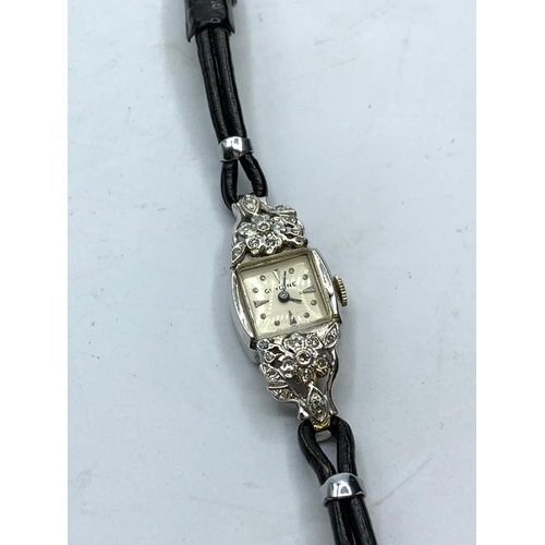 517 - 14k diamond gold and platinum cocktail watch circa 1940 full working order, weight 12g and face 1.5c...