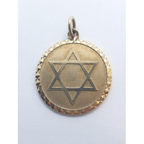 552 - 9CT Y/G STAR OF DAVID PENDANT, WEIGHT 7.2G AND 42MM DIAMETER APPROX