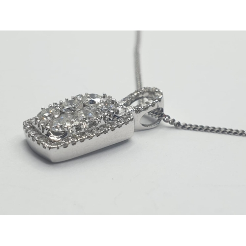 560 - 18CT W/G CHAIN AND FANCY DIAMOND CLUSTER PENDANT 0.80CT, WEIGHT 3.6G AND 46CM LONG APPROX