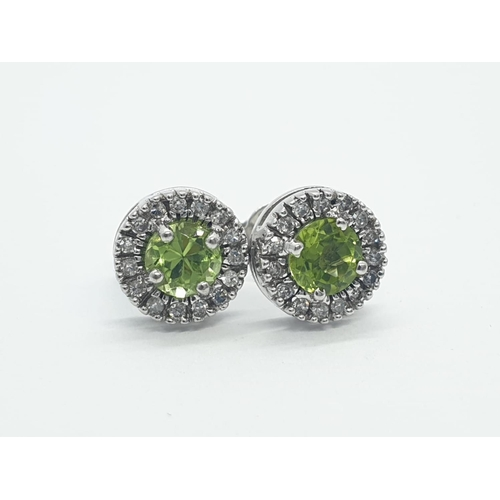 596 - 9CT W/G DIAMOND AND PERIDOT STUD CLUSTER EARRINGS, WEIGHT 2.6G