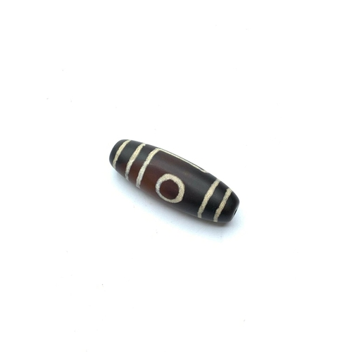 579 - Tibetan Zee agate bead, 28g weight and 5cm long approx