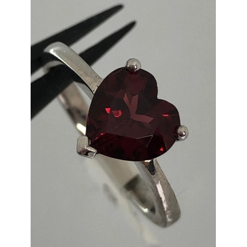 384 - Silver ring with heart shaped garnet stone, size M & weight 2.9g