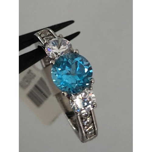 385 - Silver ring with natural topaz and cz; weight 2.5G; size J1/2