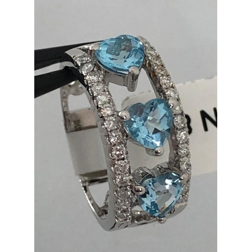 609 - 18k white gold ring with diamonds 0.38cts and blue topazes ( 3 stones, heart shape 5.5x5.2mm approxi...