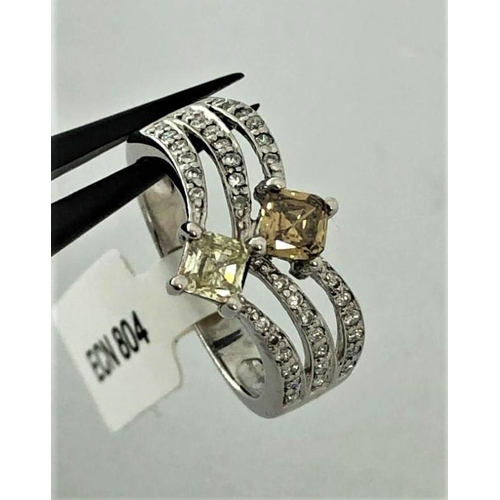611 - (WITHDRAWN) 18k white gold ring with diamonds- 2 centre diamonds yellow and brown around 0.59cts and...