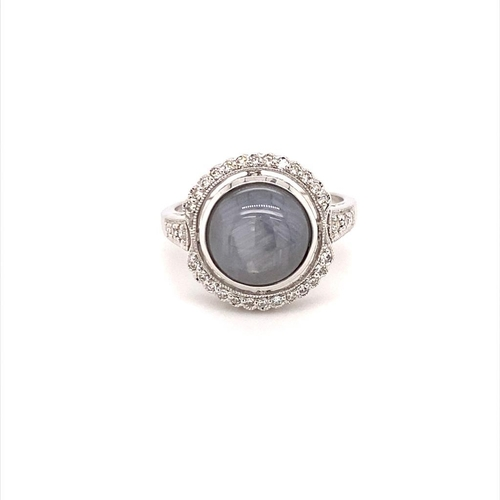 617 - 18ct white gold ring with 5.5ct round miligrain halo star sapphire, 0.25ct side diamonds (F/G colour...