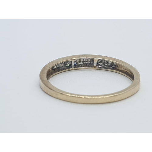 616 - 9CT Y/G DIAMOND CHANNEL SET HALF ETERNITY RING , WEIGHT 1.5G AND 0.25CT APPROX SIZE N1/2