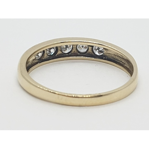 633 - 9CT Y/G DIAMOND BAND RING 0.20CT APPROX, WEIGHT 1.8G AND SIZE L