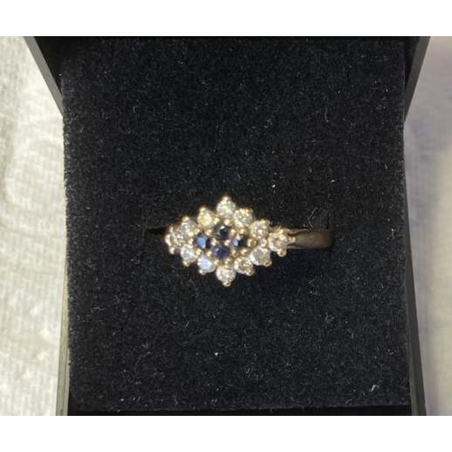 632 - 9ct Gold Cluster ring having Sapphires to centre and clear zirconia surround. Stones mounted in marq...