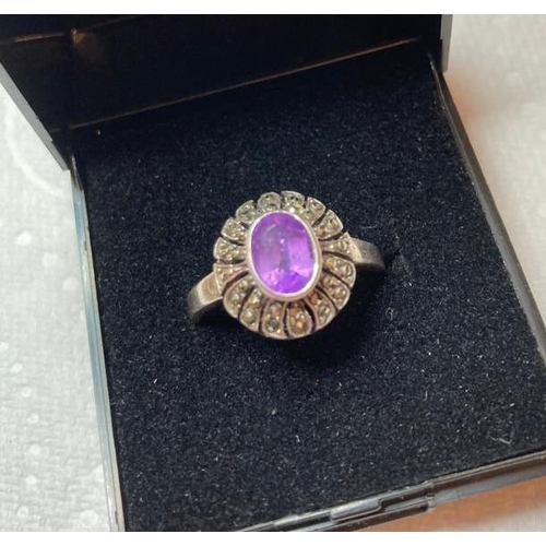 654 - Vintage Silver Marcasite and Amethyst ring having oval amethyst to centre with marcasite cluster sur...
