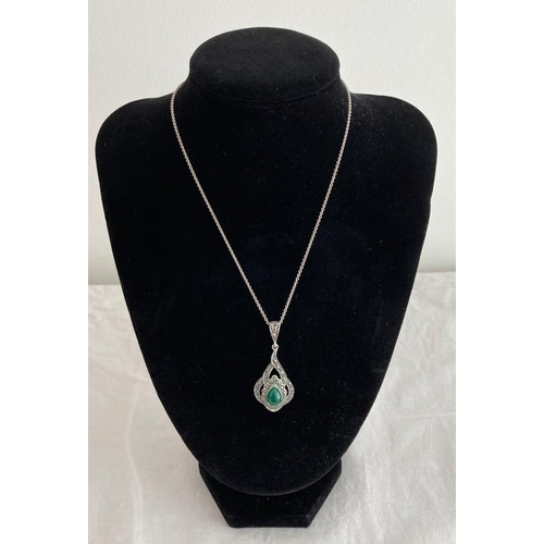 656 - Silver Pendant and Chain Pendant having Victorian design with marcasite surround and green pear drop...