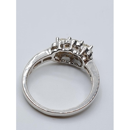 655 - 18ct white gold diamond cluster ring, weight 4.5g and 0.60ct diamonds approx size M