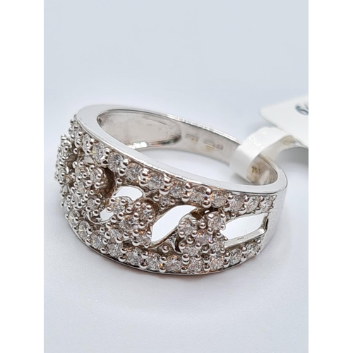 659 - 18ct white gold diamond set fancy band ring, weight 5.7g and 0.85ct diamonds approx, size N