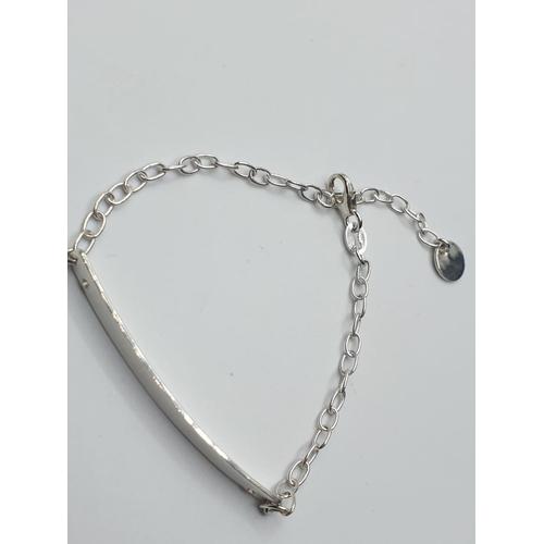 669 - Sterling silver ID bracelet