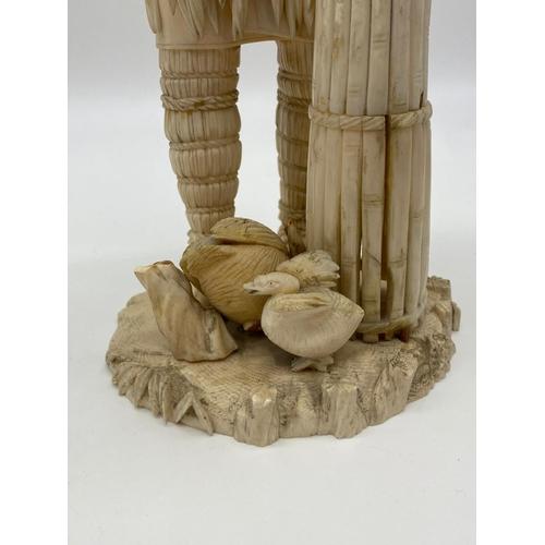 639 - Bone Chinese STATUE.  34cm tall.