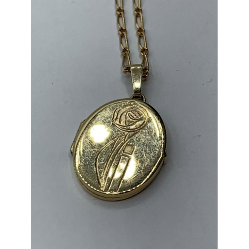 62 - 9CT YELLOW GOLD OVAL LOCKET AND CHAIN