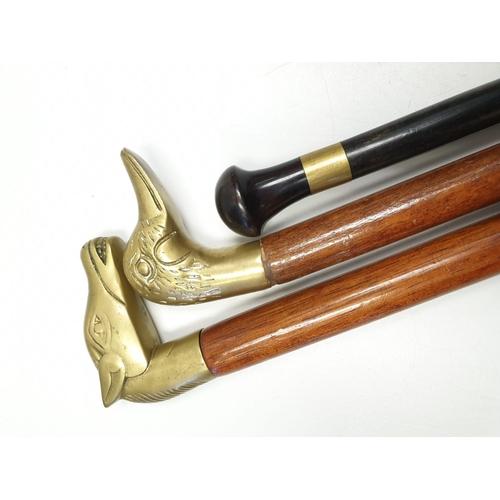 678 - 3 x wooden WALKING STICKS.  89cm.  2 with metal animal heads.