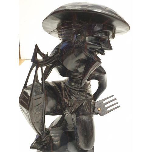 690 - Chinese wooden figure of a RICE SALESMAN.  32cm high.  1.9kg.