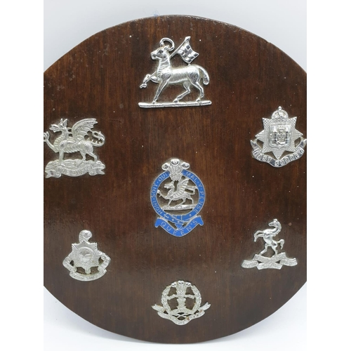 703 - Wooden plaque with Army regimental badges.