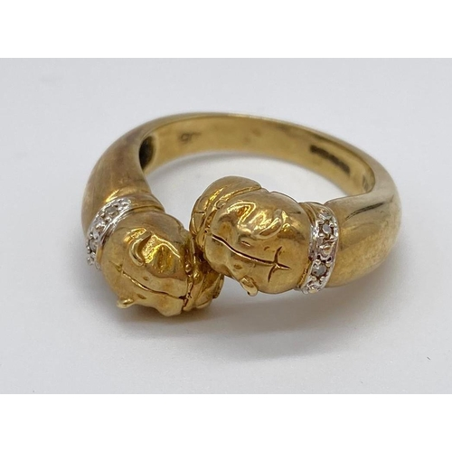 714 - A bulldog ring in 9ct gold with diamond collars, weight 7.9g & size U