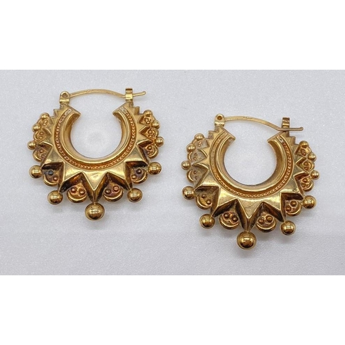716 - Pair of ornate 9ct gold earrings, weight 2.4g