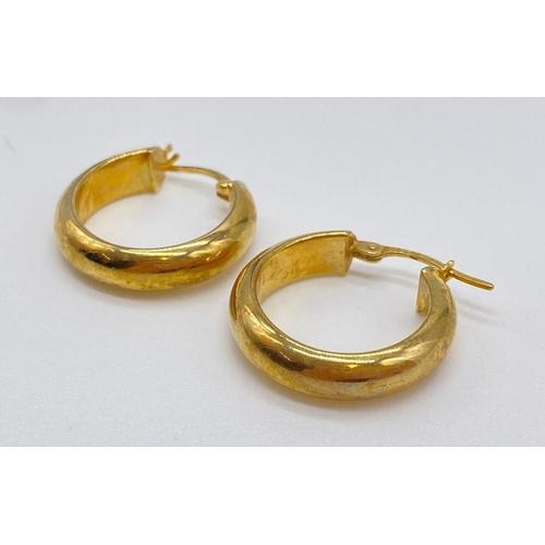 717 - Pair of 9ct gold hoop earrings, weight 1.8g