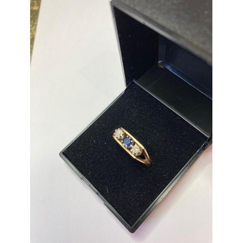 750 - 9ct Gold Three Stone Ring having Centre Sapphire with an illusion set diamond to each side. Modernis...