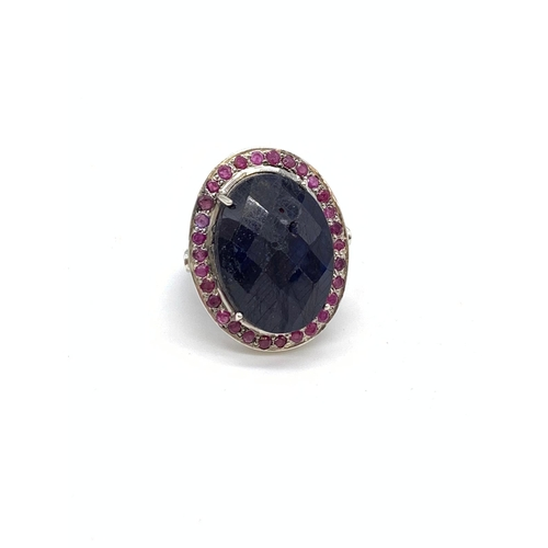 798 - Blue Sapphire 925 Silver Ring with 25.3ct Sapphire and 1.50ct Rubies, Small knick to sapphire on tab...