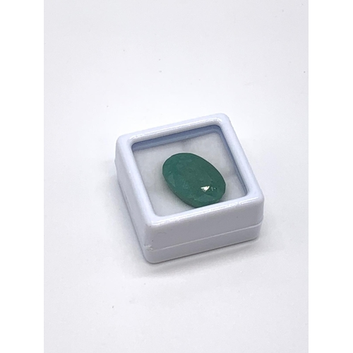 826 - 11.60ct Oval Colour Enhanced Emerald Gemstone GLI certified