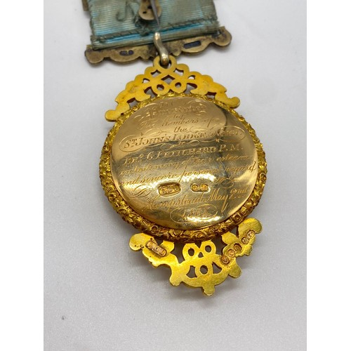 707 - 18ct gold Masonic jewel dated 1865 from the St's John lodge Hampstead number 167, weight 62.3g total...
